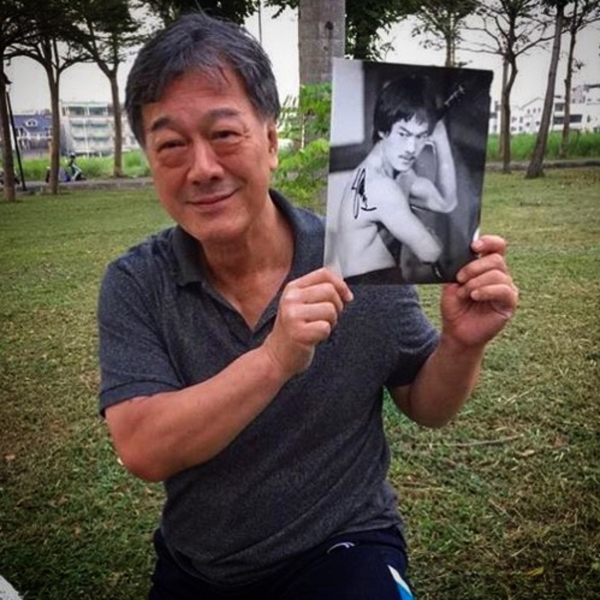 Bruce Li holds a signed photograph of himself during the filming of Michael Worth's 2017 Bruceploitation documentary.