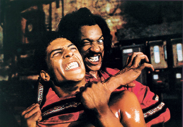 Sho'nuff (Julius Carry) gets 'Bruce' Leroy Green (Taimak) into a headlock in this production still from Berry Gordy's The Last Dragon (1985).